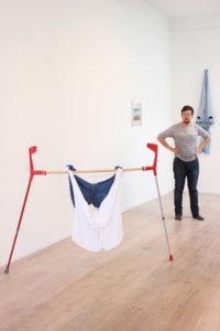 Juan Pablo Plazas installationview in front: Protheses 2014 180 x 126,5 cm Plastic, aluminium, hout, sizal, katoen, papier